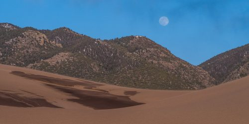 great sand dunes with moon