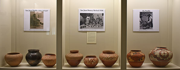 three displays side by side with san juan pottery and zia pottery
