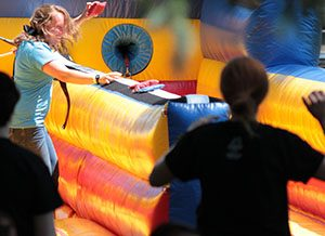 Counselor Education students playing tug on inflatables