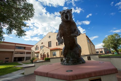 Old Mose Grizzly bear in front of Rex Activity Center Adams State Campus