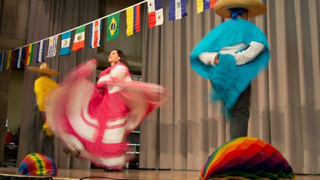 students dancing in costume at pan american days
