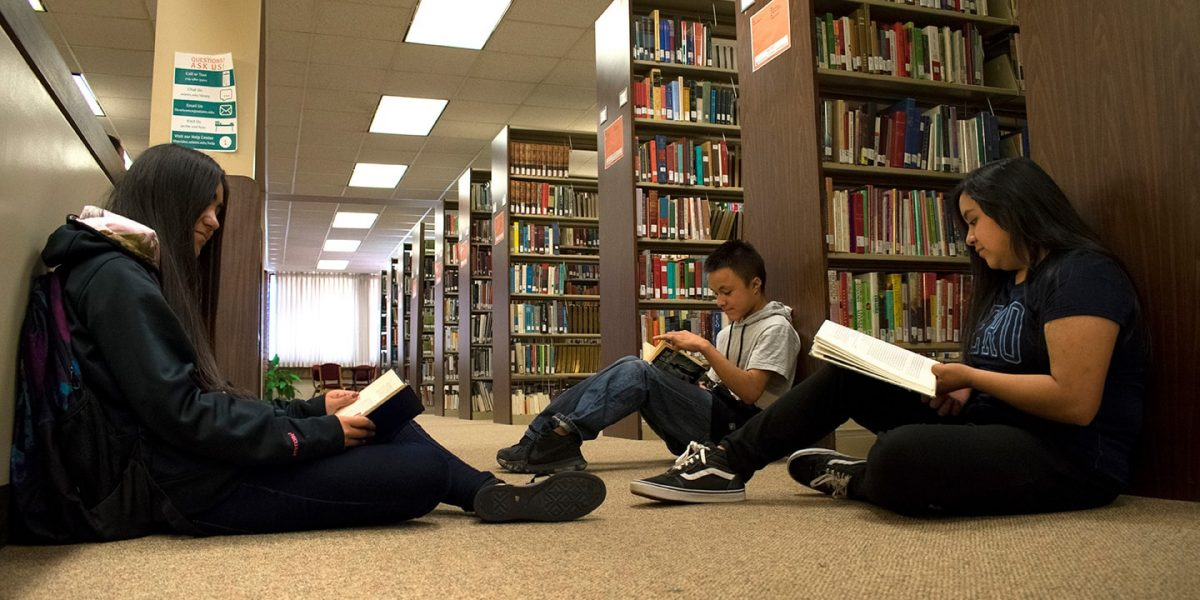 Upward Bound students reading in Nielsen Library