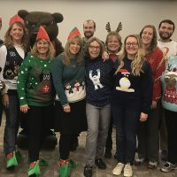Adams State faculty and staff in holiday sweaters