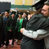 adams state graduates in plachy field house