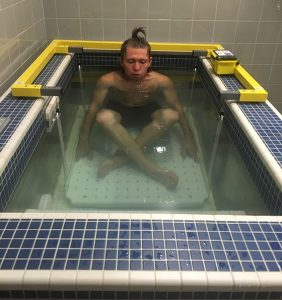 Chad Palmer tests out the Adams State Performance Lab underwater
