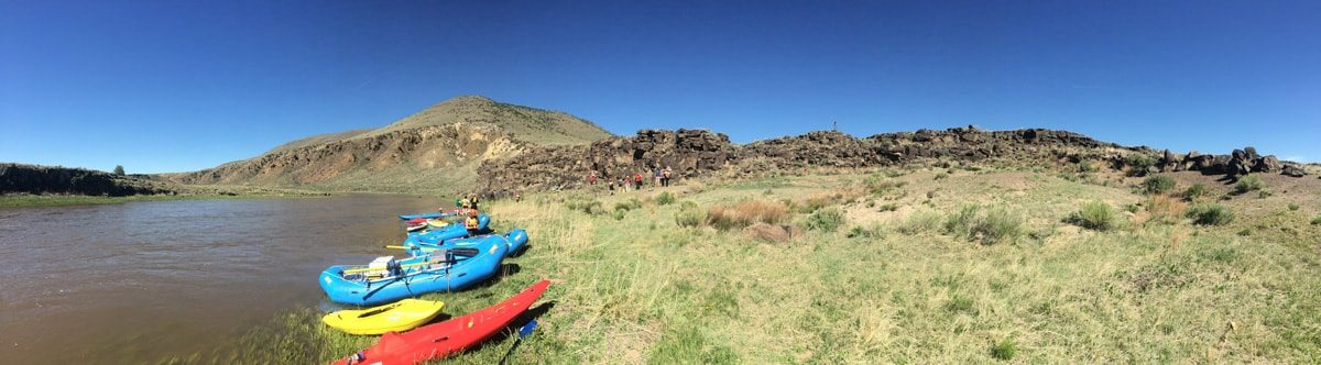 kayaks and canoes on the shore of the Rio Grande