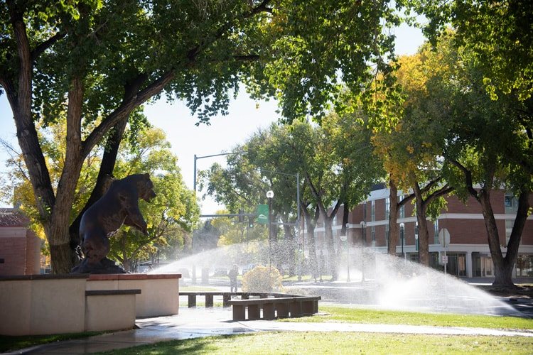 Fall campus with old mose, the grizzly and sprinklers