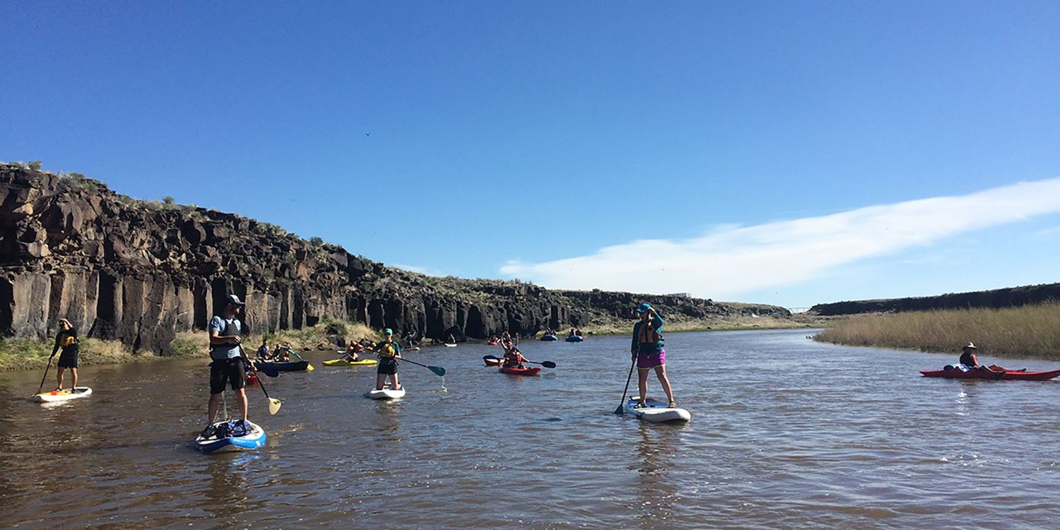 paddle boarding on river