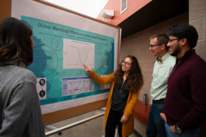 Student pointing to global warming research