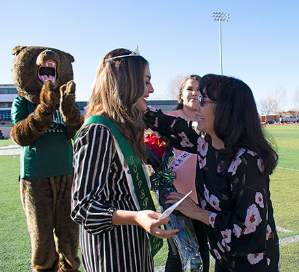 Maria Valdez presents the 2019 Spud Bowl Queen Danae Lucero, Sargent High School, with flowers.