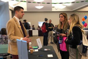 Students talking to recruiters at on campus career fair