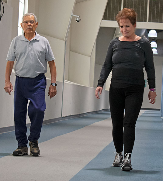 David Ruybal walks the track at the Alamosa Recreational Center with his wife, Cindy