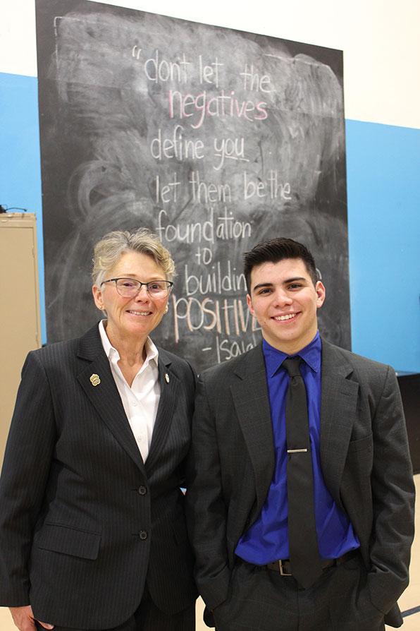 Adams State President Cheryl D Lovell and Isaiah Avila