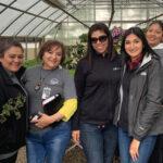 Migrant Education Program Staff a green house