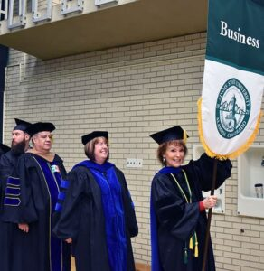 Patricia Robbins leads business professors at commencement