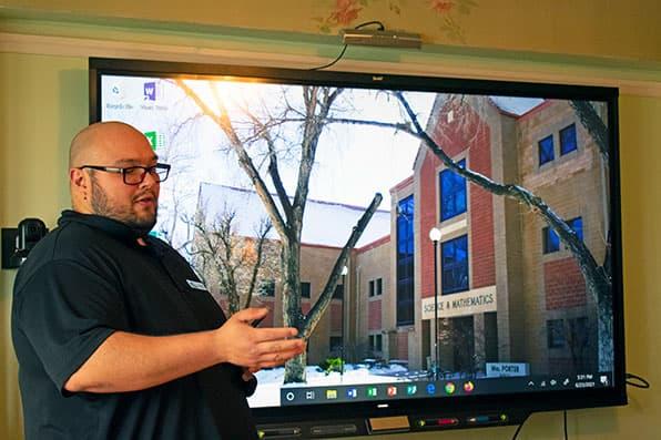 Alfonso Velasquez demonstrates Smartboard
