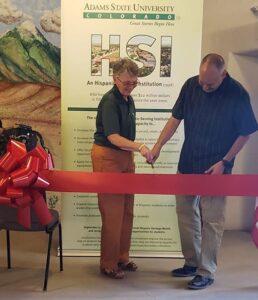 Adams State President Cheryl D. Lovell and Eric Carpio cut ribbon
