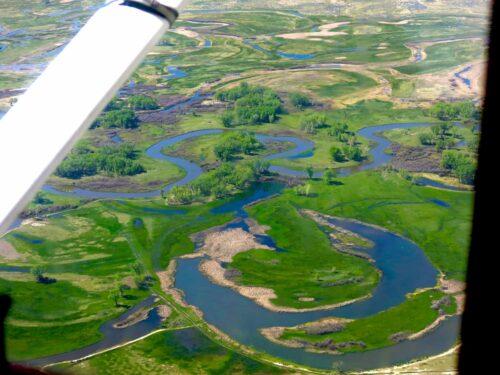 Rio grande snakes through a landscape as seen by a plane