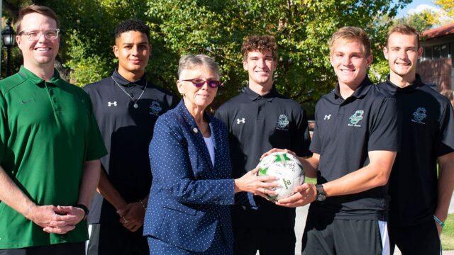 Adams State President receives signed men's soccer ball